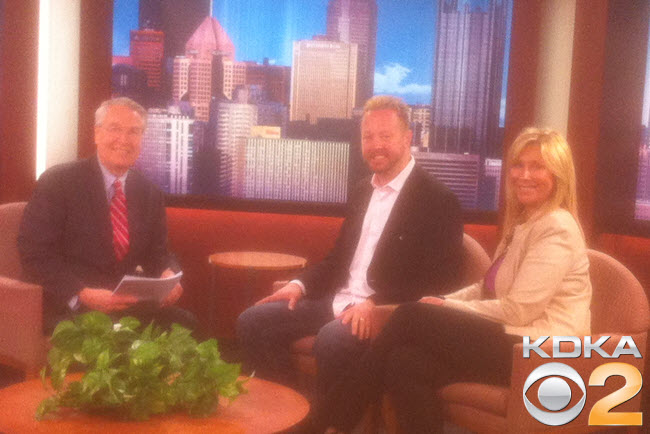 John and Kelly Giles on the set of Sunday Business Page with Jon Delano