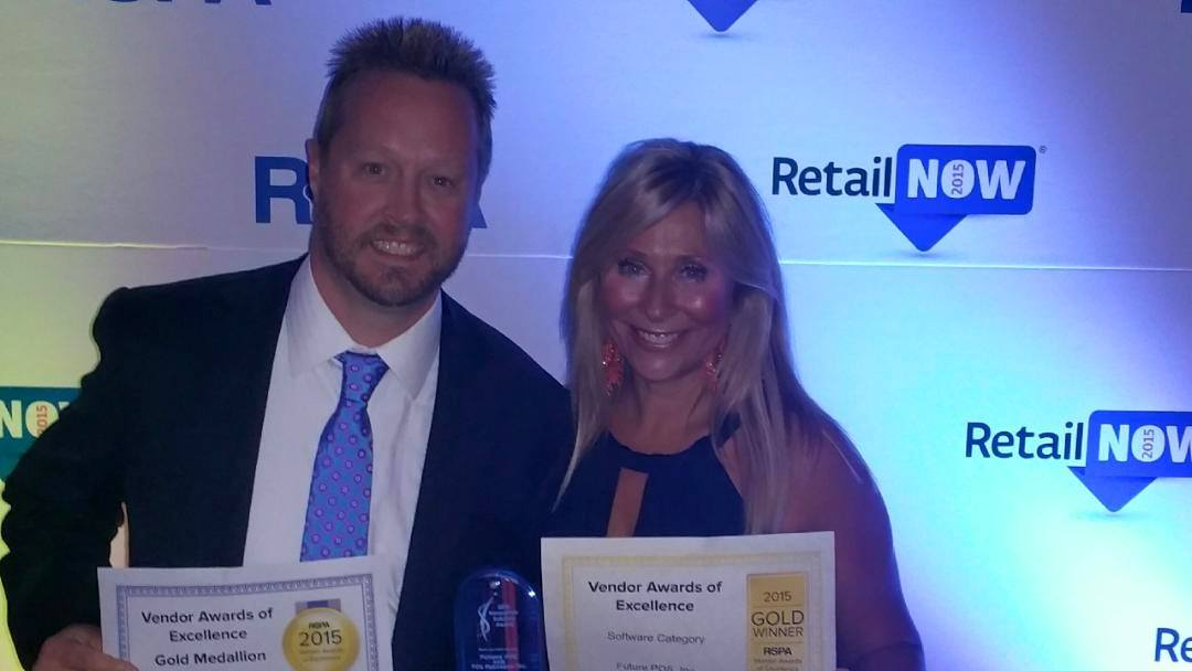 John and Kelly Giles holding 3 awards for Future POS